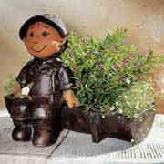 Gärtner mit Blumenbeet, mit Beschriftung